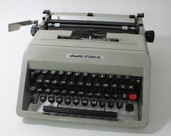 Vintage Olivetti Studio 45 portable manual typewriter with original hard plastic case