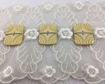 Three Vintage Carved Rectangular Celluloid Buttons