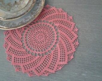 model pink spiral crochet doily