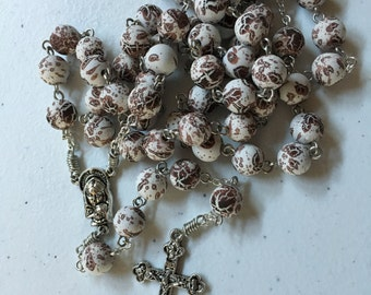 10mm brown and white speckle rubber bead rosary with Madonna and Child center