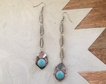 Boho turquoise and feather fringe earrings.