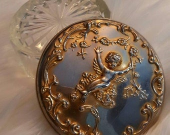 Vintage powder dish with mirrored lid.