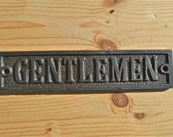 A solid cast iron antique style Gentlemen toilet sign WH24