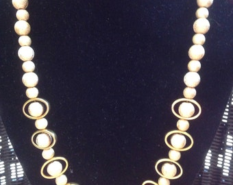 Gold tone beads and matching earrings