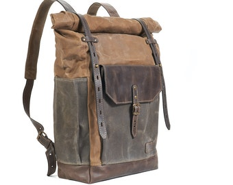 Brown canvas rolltop backpack. For work and travel