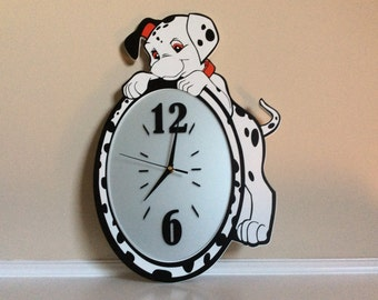 A Cute Large 101 Dalmations Quartz  Wall Clock with a Puppy Hanging off the Top