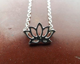 Lotus flower necklace.