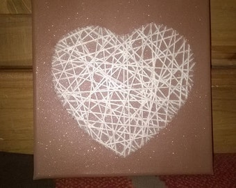 woollen heart on a canvas