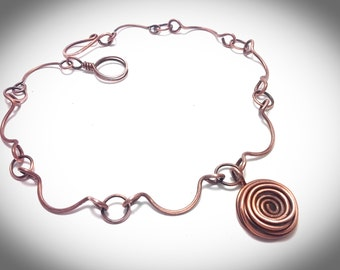 Copper wire necklace.  Scallop linked necklace with large copper spiral rosette pendant
