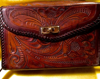 Vintage Hand tooled Western handbag with a carved and tooled floral design.
