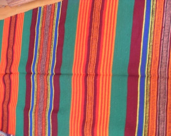 Bright vintage rug.Hand-woven and woolen yarn dyed with natural materials on cotton basis.size 3.5m / 1,00 m