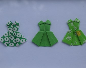 Framed origami dresses in shades of green