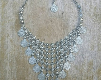 Tribal inspired silver coin necklace.