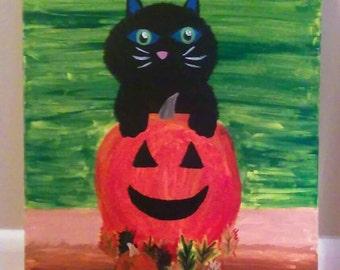 Halloween pumpkin and black cat
