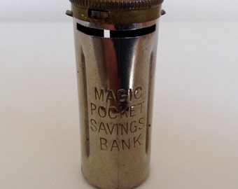 "Memorabilia- Magic Pocket Savings Bank - Saving ""sixpences""."