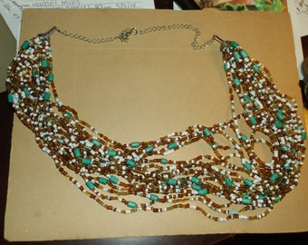 Vintage Multi Strand bugle Bead Necklace..Browns, Aqua, white..Ajustable