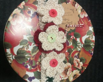gift tin with crochet flower band