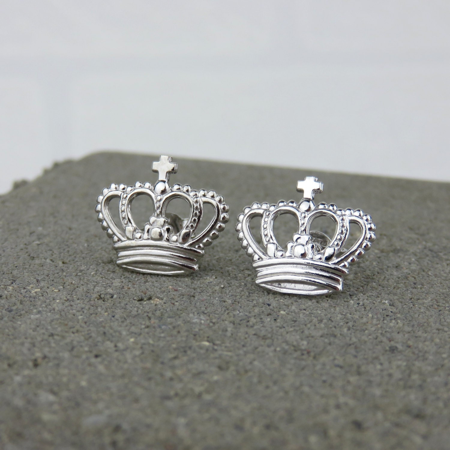 silver crown stud earrings available in yellow gold