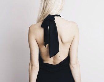 ONYX GODDESS sheer black bodysuit with a bow on the back
