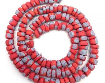 Coconut beads, pink-orange with spots, 5 mm, Pukalite