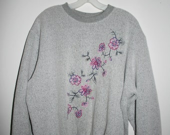large grey sweater with embroidered flowers