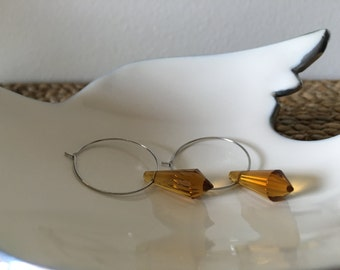 Stunning Amber glass crystal dangle hoop earrings. These earrings will give you all the right angles.