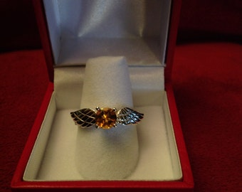 Beautiful sterling silver ring inspired by the Golden Snitch.