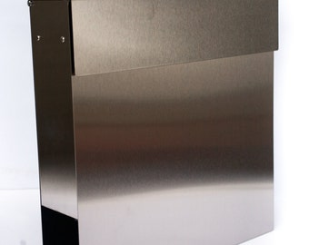 Silver stainless steel modern mailbox. Very stylish steel mailbox with lock. Durable postbox in silver colour
