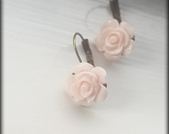 Lever Back Earrings with Pale Pink Resin Flowers. Bronze Tone
