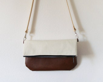 Small canvas fold-over crossbody bag with zipper