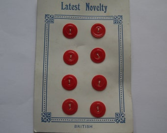 A set of Eight Red Vintage Buttons.