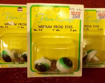 Three sets of green frog eyes for crafts