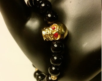 Red eyed Gold skull Charm Bracelet