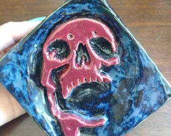 Ceramic skull sculpture