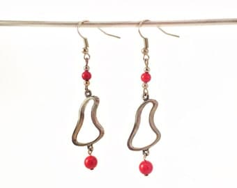 Long earrings with red pearls
