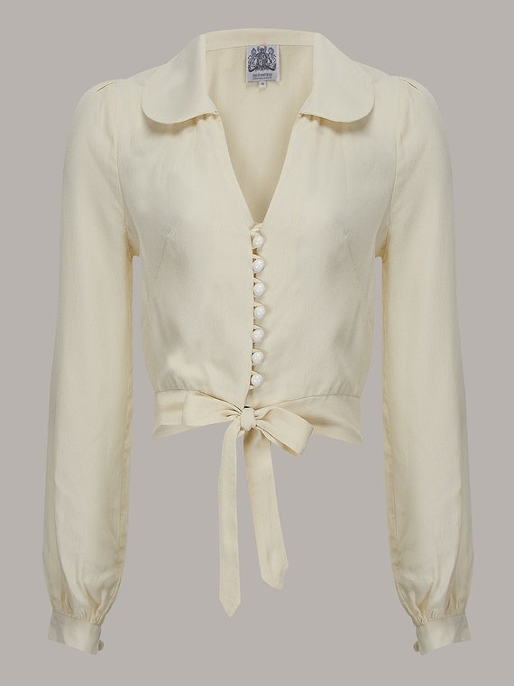 1940s Dresses and Clothing UK | 40s Shoes UK 40s Vintage Inspired Clarice Blouse in Cream by The Seamstress of Bloomsbury $50.32 AT vintagedancer.com