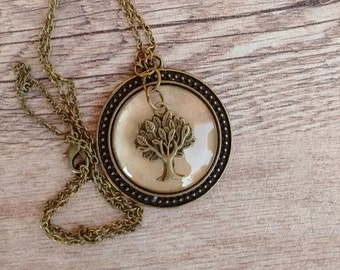 Pendant with tree on gold background