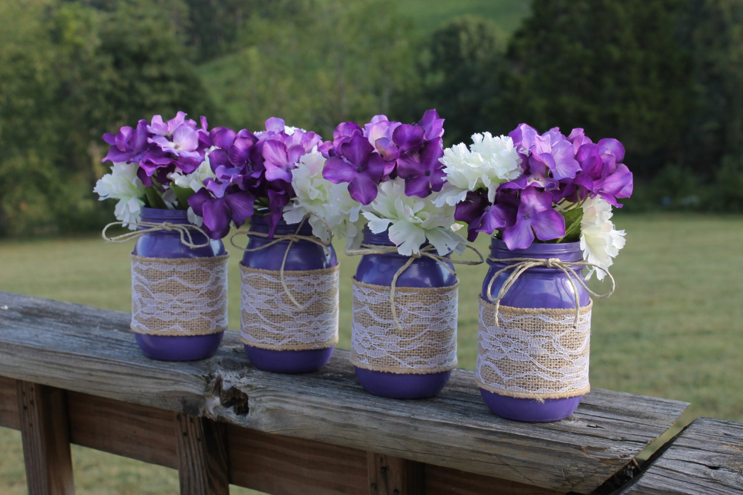 Purple country rustic wedding mason jar centerpieces