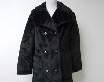 "Montgomery Ward  .  faux fur double breasted coat . bust 39"" . fits a medium to large . Union Made . Made in USA"
