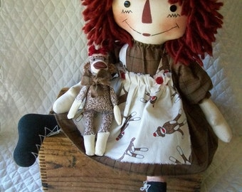 Primitive cute Raggedy Ann doll with sock monkey in cream and brown by yellowsweetpotato