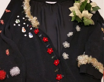 Ugly holiday sweater with tinsel trim