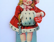 Vintage 1923 Mechanical Valentines Day Die Cut Card Little Girl Holding Heart and Skates - Moving Eyes - made in Germany - Winter  ephemera