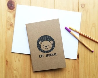 happy lion hand printed journal. woodland animal sketchbook. doodle notebook. blank travel journal. white pages. large size (A5)