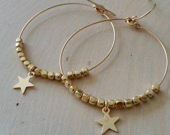 Star charm hoop dangle earrings. Unique gold earrings. Delicate. Dainty. Minimalist. Gift