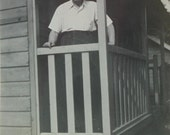 Vintage Photograph - Man Stood in a Wood Cabin
