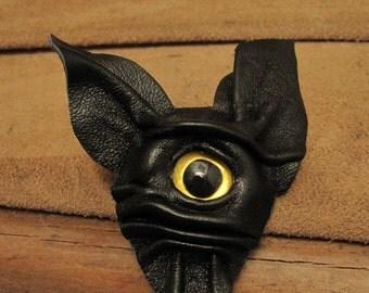 Grichels leather pin/tie tack/brooch - black with custom metallic yellow fish eye