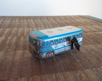 Vintage Little Windup Lithographed Tin Greyhound Bus Toy