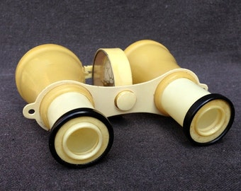 The antique white binoculars glasses multifunction collectible tool compass.