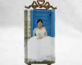 Vintage french brass easel back picture frame with beveled glass ball feet ribbon swag Louis XVI style