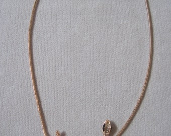A Tasteful Coiled Crystal Snake Pendant in Rose Gold Snake Chain